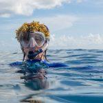 Allison Stillman in the ocean with seaweed on her head